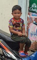 boy sitting on a motorcycle (the foreign photographer - ฝรั่งถ่) Tags: apr302016nikon boy child sitting motorcycle khlong lard phrao portraits bangkhen bangkok thailand nikon d3200