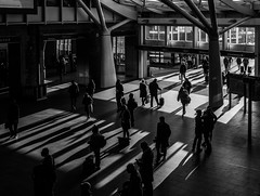 Travellers to and from the light (Marion McM) Tags: monochrome blackandwhite contrast station railwaystation passengers travellers backlit lowsun shadows kingscrossstation london england streetphotography entrance 2018