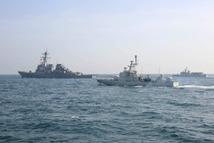 USS Decatur (DDG 73), left, leads Royal Bahrain Naval Force vessels in formation during exercise Neon Union 19.