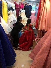 Ashley wasn't there so I tried the gown :) (ghostgirl_Annver) Tags: asia asian girl annver teen preteen child kid daughter sister family gown shop red try back backshot