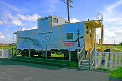 CSX Caboose, CSX Yeoman Yard, Tampa Terminal Subdivision, Tampa, Florida (1 of 2) (gg1electrice60) Tags: looklistenlive operationlifesaver csxcaboose caboose 5656adamodrivetampaflorida33619 5656adamodrtampafl33619 cabcabeesecrummy cabin businesscar rollingstock advertisingbillboard floridabusinessunit tampaterminalsubdivision yeomanyard freightyard csxyeomanrailyard sline freightline formerseaboardairlinerailyard formersalrailyard seaboard railroadyard rryard billboard logo csx csxt office mural extendedvisioncaboose coupola telephonepole lightpole