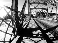 Rue Charlevoix Metal Bridge (Montreal) (MassiveKontent) Tags: streetphotography bwphotography streetshot architecture geometric lines pointsaintcharles montreal bw contrast city monochrome urban blackandwhite street photo montréal quebec canada photography concrete shadows noiretblanc blancoynegro bridge metal charlevoix symmetry