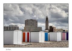 Le Havre - Contraste architectural (Rémi Marchand) Tags: lehavre normandie hautenormandie plage ville cabines cabinesdeplage city seinemaritime cityscape canoneos7d architecture patrimoine église eglisesaintjoseph augusteperret ciel nuages patrimoinemondialdelunesco galets beach