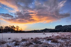 Winter morning, Norway (Vest der ute) Tags: xt2 norway rogaland haugesund eivindsvatnet snow lake grass winter sunrise sky clouds trees houses morning fav25