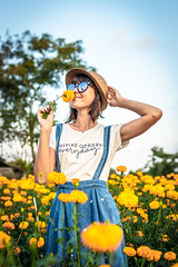 Close up portrait of happy and beautiful young woman relaxing enjoying the fresh beauty of gorgeous orange marigold flowers field in travel and holidays. Bali island. (Artem Bali) Tags: field woman beautiful girl marigold nature summer happy young beauty green orange pretty garden travel freedom fresh model portrait tropical asia asian attractive enjoying farm flowers traveler trip tourism destination hair thailand people pic selfie happiness photo bloom indonesia valley blossom fun floral spring background hat female plant sunny blogger