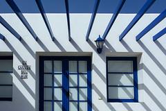 La casita del mar (Jan van der Wolf) Tags: map194139vv shadowplay shadows schaduw schaduwen schaduwspel lanzarote blue blauw door deur window raam lamp light lijnen lijnenspel interplayoflines playoflines lacasitadelmar facade gevel house huis casita lagraciosa