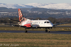 G-LGND Saab 340B Loganair Glasgow airport EGPF 02.02-19 (rjonsen) Tags: plane airplane aircraft aviation airliner snow airside taxying turboprop motion blur tartan