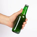 Hand holding beer bottle without label isolated on white background