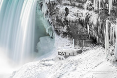 Frozen Niagara (HisPhotographs.com) Tags: niagarafalls snow ice cold winter brutal ontario canada niagara falls waterfall waterfalls white whiteout snowing longexposure bigfall bigfalls bigwaterfall wonderoftheworld hisandherphotographs