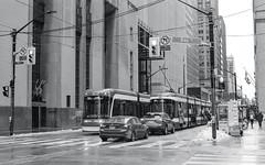 Pair of King St. Streetcars (Bill Smith1) Tags: believeinfilm billsmithsphotography canonnewf1 fdn50f14lens hc110b heyfsc kodaktrix4001600 toronto