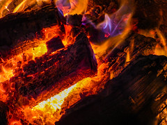 Feeling the Heat (Steve Taylor (Photography)) Tags: log fire embers heat flame red white mauve brown wood glow christchurch canterbury southisland timber newzealand nz bright yellow