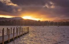 A Golden End (Captain Nikon) Tags: waterhead windermere lakewindermere cumbria thelakedistrictnationalpark thelakes uk greatbritain outdoorphotography jetty sunset yachts mountains moody
