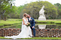 "Bride and groom with ""Youth Taming the Wild"" sculpture in the background - Brookgreen Gardens (Ryan Smith Photography) Tags: brookgreengardens boots bride groom pond romantic sculpture wedding weddingphotography myrtlebeach httpswwwryansmithphotographycom"