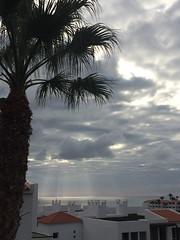 Sunlight on sea (markshephard800) Tags: fuerteventura sea sunlight rays sun soleil grey clouds nuages gris palm tree hotel chimneys