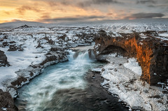 Freezing Warmth ..? (Pete Rowbottom, Wigan, UK) Tags: iceland ice snow winter icelandlandscape landscape flowingwater waterfall cold freezing sunset sunlight sun clouds moody island cliff light glow hiking godafoss beauty nature peterowbottom nikond810 nisifilters dramatic wilderness wild remote europe northerniceland goldenlight goldenhour pastel detail outdoors 2018 rocks cave geology volcanic hills mountains icicles freeze texture
