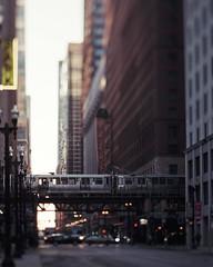 Elevated CTA Train (Jovan Jimenez) Tags: elevated cta train canon eos elan 7ne tilt shift hasselblad carl zeiss planar 80mm f28 fujicolor c200 35mm film chicago 7s 30v 33v miniature fujifilm analogue analog bokeh building city