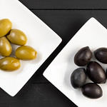 Flat lay above Green and Black Olives on the plate thumbnail