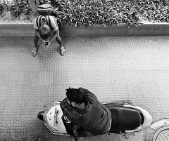 rest 3 (Dean Forbes) Tags: india bangalore man nap scooter bw
