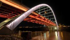 Crossing Over (TnOlyShooter) Tags: nashville tennessee skyline night em1markii 918mm mirrorless olympus koreanveteransbridge cumberlandriver reflections