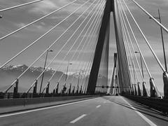 Η γέφυρα Ρίου – Αντιρρίου «Χαρίλαος Τρικούπης» P1070389 (amalia_mar) Tags: «χαρίλαοστρικούπησ» γέφυραρίου–αντιρρίου ελλάδα βουνά χιόνι ουρανόσ σύννεφα ασπρομαυρο charilaostrikoupis bridge rioantirrio greece mountains snow sky clouds bw sundaylights crazytuesday blackandwhite