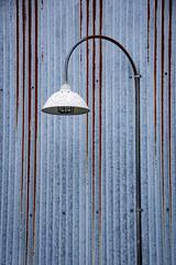 Minimalist (Katrina Wright) Tags: dsc3200 lamp corrugated metal siding rust stripes line pattern weathered granvilleisland