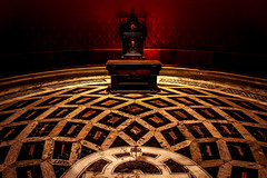 One throne (Fran Caparros) Tags: seville sevilla catedral cathedral museum museo spain españa europe europa unesco world heritage andalucia chair silla throne trono palace palacio geometrico geomtrical floor stones red rojo arte art history historia power medieval kings monarchy game mediterranean