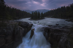 Dusk at Sunwapta Falls (NickSouvall) Tags: dusk night dark moody storm clouds long exposure cloudy sunset light blue hour purple white water waterfall sunwapta falls jasper national park canada canadian rockies rocky mountains beautiful scene river island trees forest rocks landscape nature view