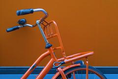 Orange bicycle (Jan van der Wolf) Tags: map192482v fiets bicycle cycle wall muur orange oranje