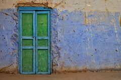 (Ghada Elchazly) Tags: egypt aswan nubia colorsinourworld coloredwalls colors colorful coloredhouses ngc flickr doors door wall texture details abstract scratches blue green