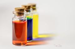 In a Bottle (Inky-NL) Tags: macromondays hardlight ingridsiemons©2019 bottle bottles red blue yellow colors dof shadow