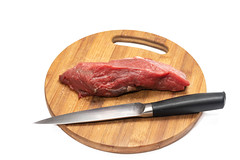 Kitchen knife and beef meat on the round wooden board (wuestenigel) Tags: lean butcher muscle cut cattle slice kitchenknife background meat red bloody uncooked cook bbq grocery beefsteak kitchenboard meal white raw steak woodenboard closeup tenderloin veal butchery isolated cow nobody loin fresh nutrition barbecue ingredient grill product fillet chop dinner food beef protein sirloin cuttingknife