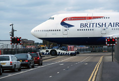 Look left, look right. Beware Whale Crossing (Longreach - Jonathan McDonnell) Tags: scan scanfromaslide 2000s 2001 1892 britishairways boeing 747 747400 747436 1892011 gbnlg britishairwaysmaintenancebase tug trafficlights crossing