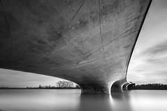 Contemplative Concrete (frank_w_aus_l) Tags: brücke bridge nijmegen netherlands nikon d810 nikkor 1424 longexposure water monochrome sw bw noiretblanc architecture sky stream reflection concrete calm