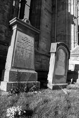 _DSC1468.jpg (Hideous Elf) Tags: abbey chruch detail grave lights melrose melroseabbey shadow stone words