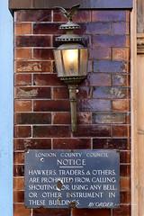 Lamplight (© Freddie) Tags: lbsouthwark bermondsey se1 bermondseystreet thewoolpack lcc londoncountycouncil notice sign enamel enamelsign hawkers traders lamp light brass