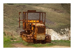 Tractor (Myrialejean) Tags: tractor bridlington northlanding sea seaside coast engineering yellow