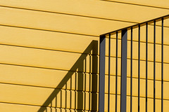 Fence,shadows and yellow wall (Jan van der Wolf) Tags: map19259v fence hek hekwerk wall muur shadow schaduw shadowplay schaduwspel yellow geel gevel facade lines lijnen lijnenspel interplayoflines playoflines monochrome