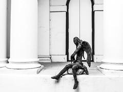 Saddened angle (Thanathip Moolvong) Tags: saddened angle sculpture armenian church singapore bw wb white black leica dlex
