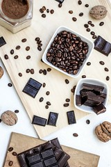 chocolate and coffee seeds on table near bowls - Credit to https://myfriendscoffee.com/ (John Beans) Tags: coffee chocolate cocoa coffeebean cafe coffeebeans shopbeans espresso coffeecup cup drink