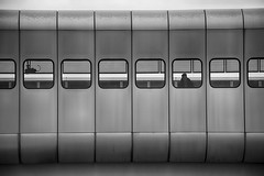 Kaisermühlen U-Bahn Station (RobertLx) Tags: 64 vienna austria europe donaucity modern contemporary metro station train transportation city looking repetition geometric bw window metallic silver dystopian lines architecture osterreich kaisermühlen ubahn donaustadt metrostation monochrome travel