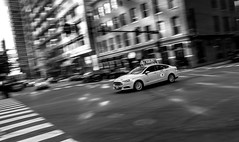 Taxi (Dkazemier) Tags: chicago taxi cab cars streets bw blackwhite blackandwhite motion