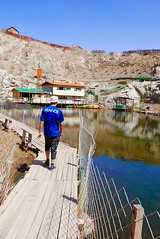 Nogoon Nuur 3 (Cath Forrest) Tags: ulaanbaatar mongolia nogoon nuur greenlake urban city gerdistrict nogoonnuur lake water blue boathouse man young rock quarry cliff wooden path walkway