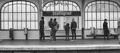 It's All Russian To Me (tcees) Tags: stalingrad metro boulevarddelavillette paris x100 fujifilm finepix urban streetphotography street bw mono monochrome blackandwhite france man woman people map window platform graffiti seat bin sign underground station