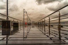 Walking in the rain, at the Pier... (cesar.toribio1218) Tags: puddles nycphotography rainy rainyday reflection cloudy beautifulclouds photography greysky bytheriver colorsofnewyork naturalbeauty fantastic greatshot vanishingpoint newyorkcityphotos