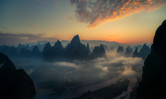 Xianggongshan sunrise (Massetti Fabrizio) Tags: sunrise sun sunset fog fabriziomassetti famasse fishermen river rural nikond4s 21mm carlzeiss21mmf28 vertical xianggongshan xiangtangshan cina clouds china mountain mount guilin guangxi guanxi gold green landscape landscapes light