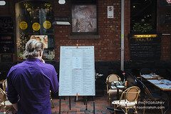 Melbourne street photography (Naomi Rahim (thanks for 4 million visits)) Tags: melbourne victoria australia 2018 travelphotography travel streetphotography street nikon nikond7200 wanderlust city 2470mm people candid man menu restaurant reading