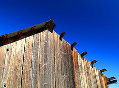 Exposed (studioferullo) Tags: architecture art beauty bright building colorful colourful colors colours contrast dark design detail edge light lines minimalism nopeople perspective pretty scene sky southwest study sunlight sunshine texture tone world sonoita arizona wood timber barn roof wall ranch