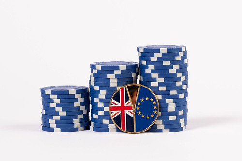 Brexit medal coin with poker chips on white background