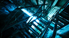 Gobblin - DSC3957 NIK+-12 wm 16x9 2k (cleansurf2 Urbex) Tags: gobblin urban urbex steel sony screensaver scale structure shadow stairs steps leadinglines light lines lowkey rustic ruin room rust rail emount exploring widescreen wallpaper 16x9 2k industrial ilce7m2 industry interior iron inside texture toned black blue color colour commercial concrete contrast cool cinamatic cinamatography architecture a7ii artistic abandoned age abstract equipment worn warehouse wideangle paint photography indoors old grime gritty grunge flare factory figure decay dark vivid vanishingpoint building background mood weird creepy creature pointofinterest