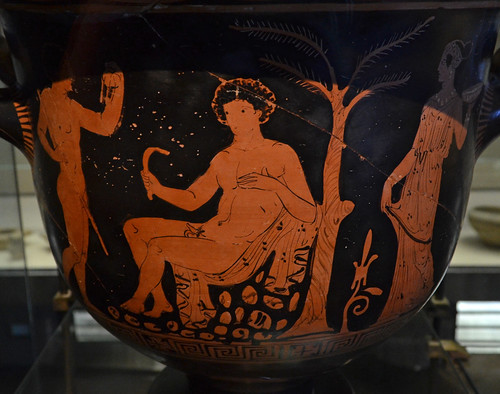 Apulian Red Figure bell krater with an athlete seated between a youth and a woman